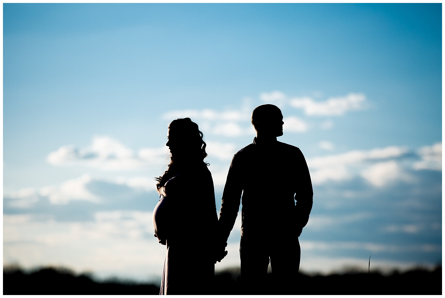 silhouette photo of a pregnant mom and dad in new jersey