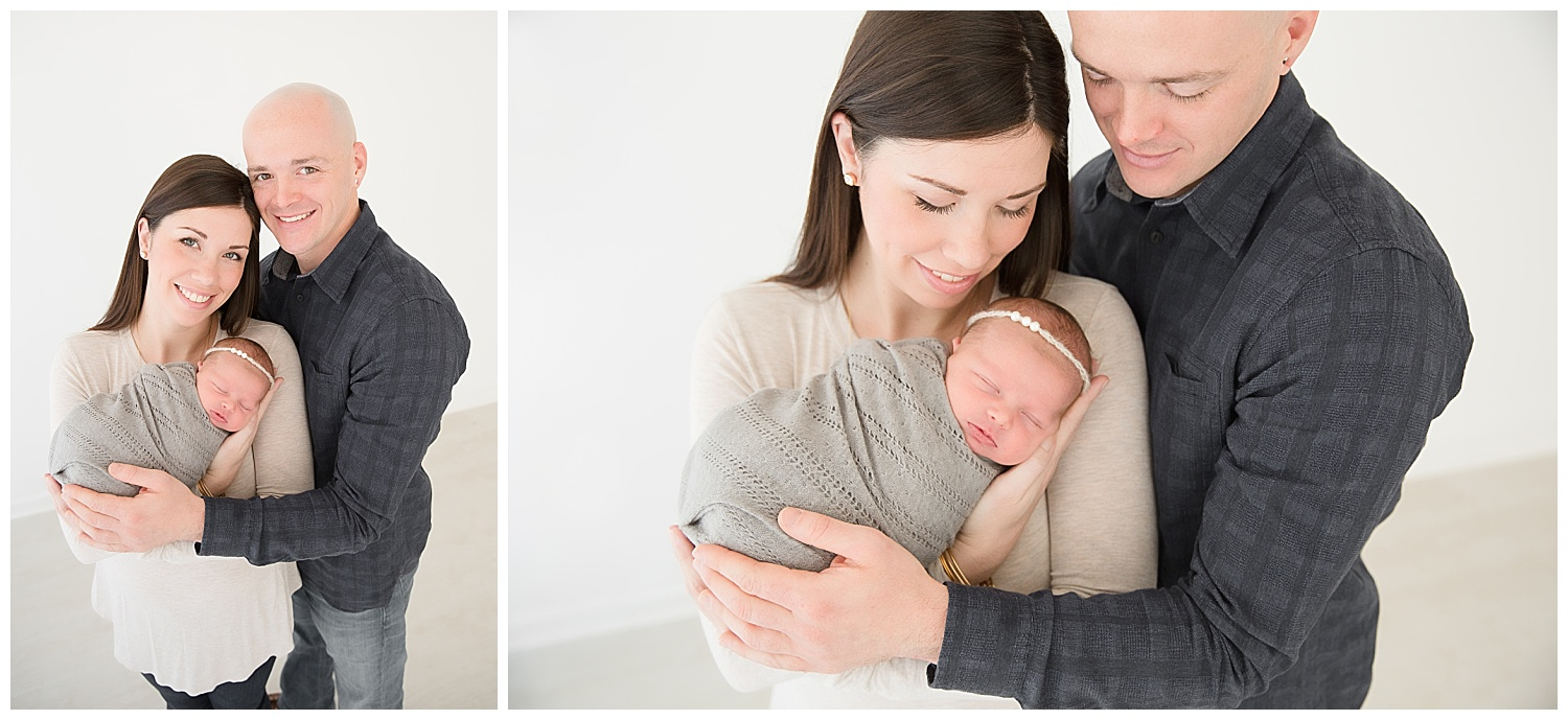 mom and dad posing for newborn photos with their baby in burlington new jersey