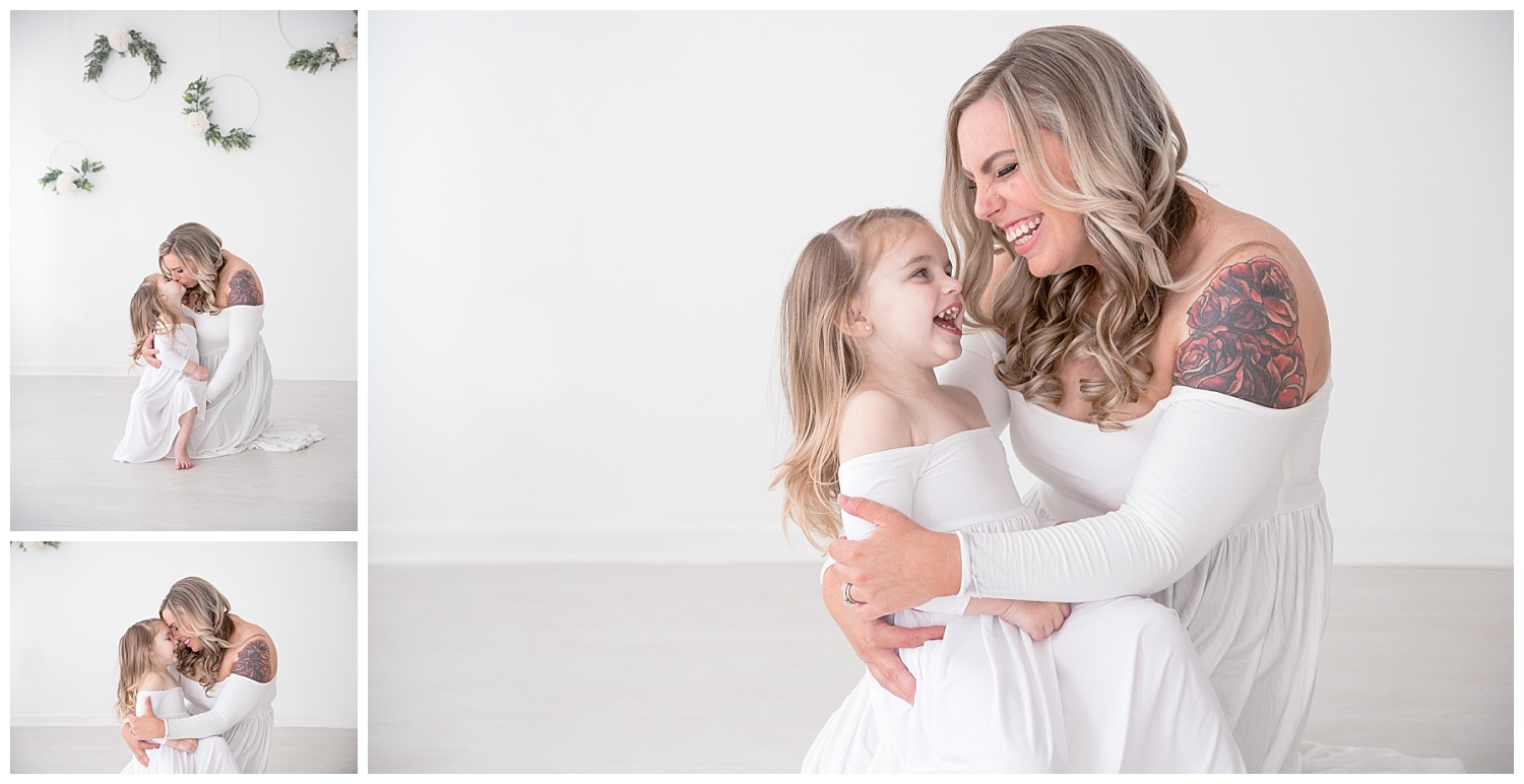 mom and daughter smiling and snuggling together for their photo shoot in burlington nj