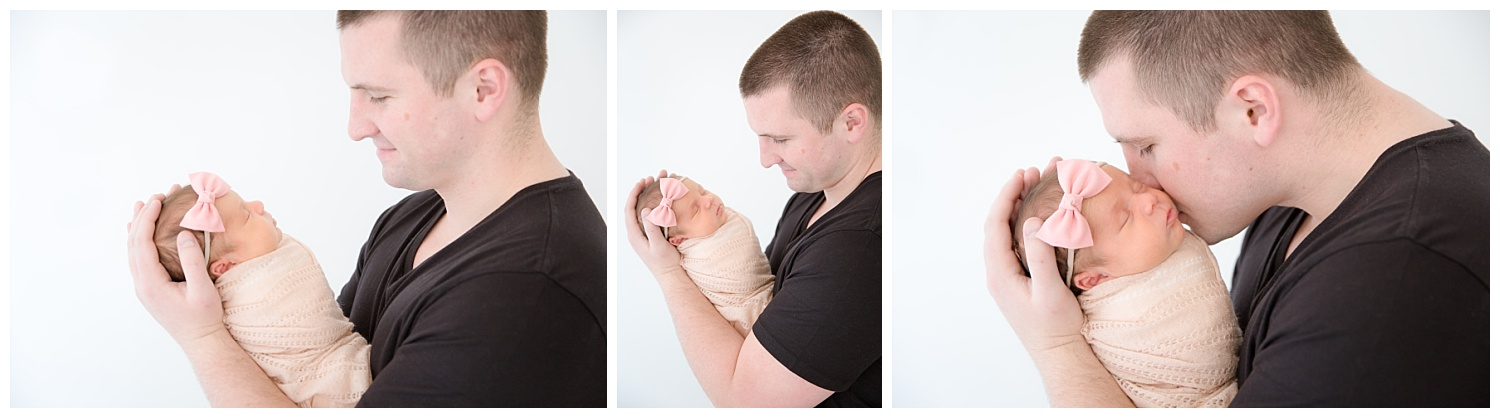 dad snuggling his little girl who is wearing a blush pink in burlington new jersey photo studio