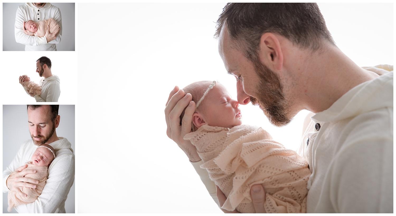 dad snuggling his newborn baby girl for pictures in burlington new jersey studio