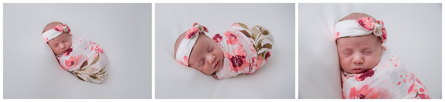 baby girl wrapped up in a flower wrap and headband in moorestown new jersey studio