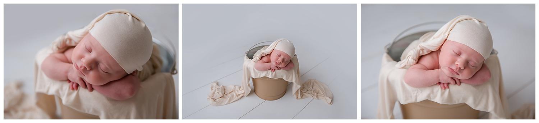 sleeping baby in a bucket wearing cream in moorestown new jersey photo studio