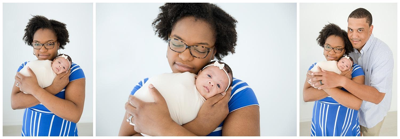 mom holding her newborn baby girl in moorestown nj studio