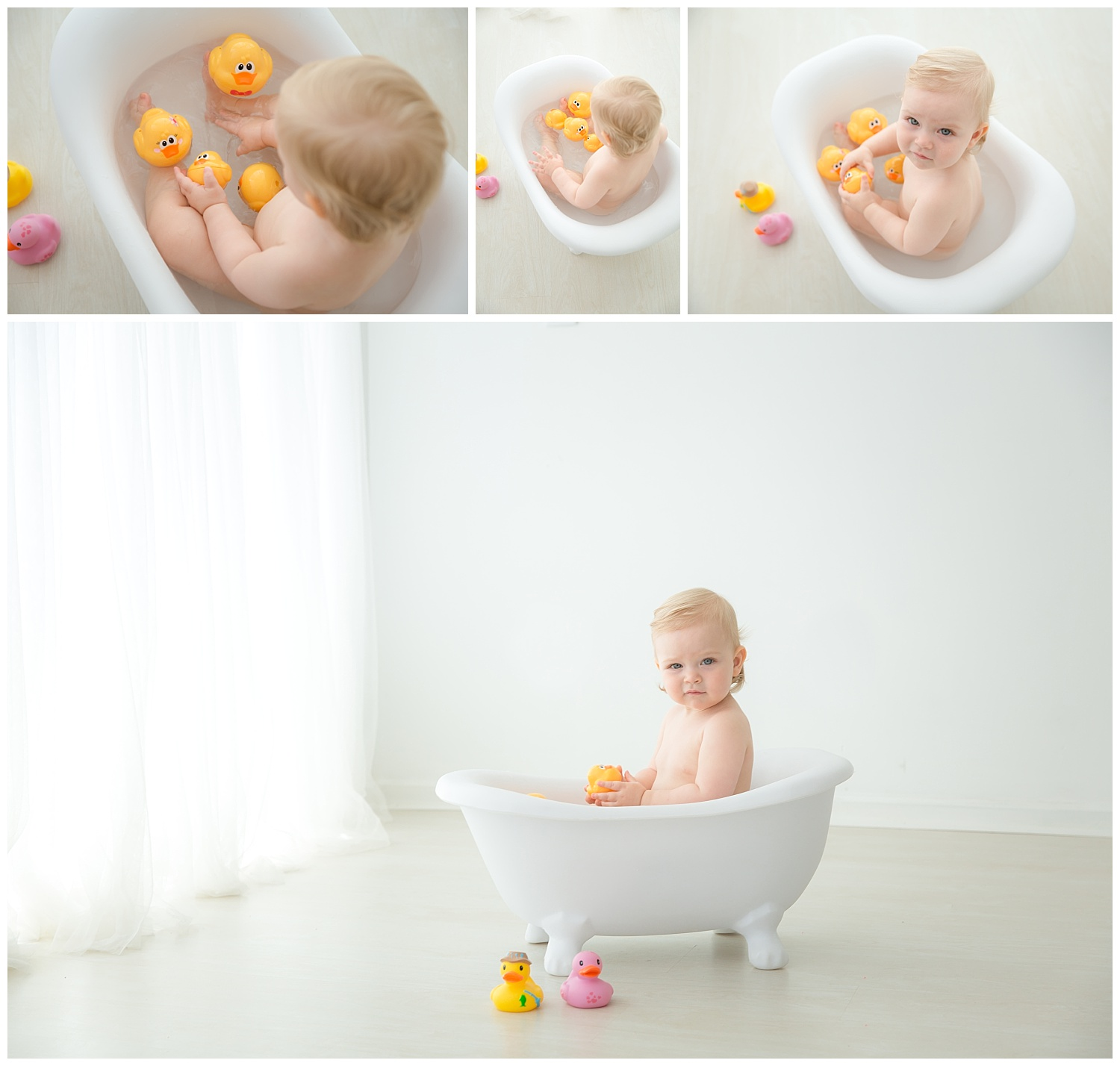 blonde little girl in a white claw foot tub in moorestown new jersey splashing in water and rubber duckies