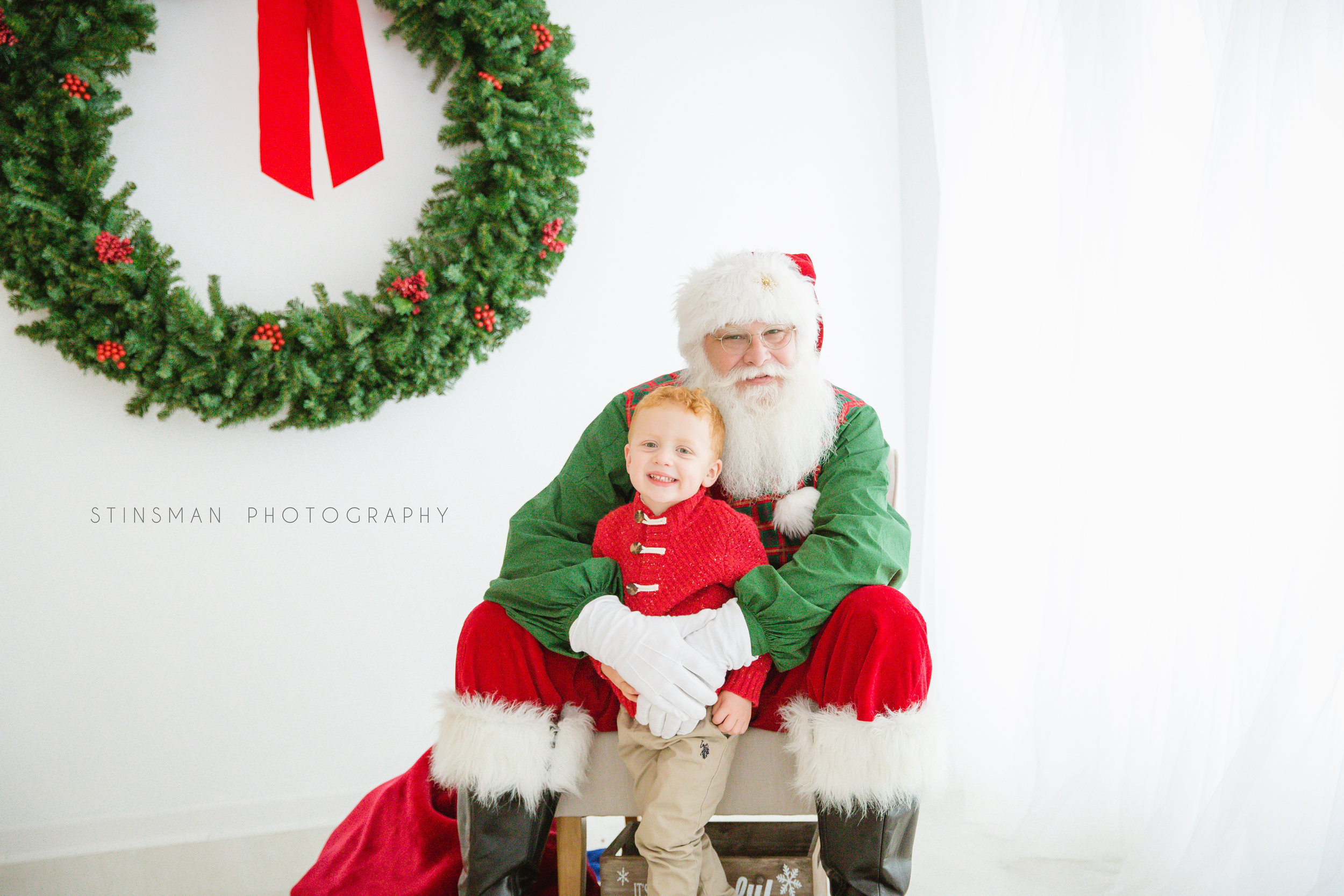 little boy hugging Santa in burlington nj photo studio