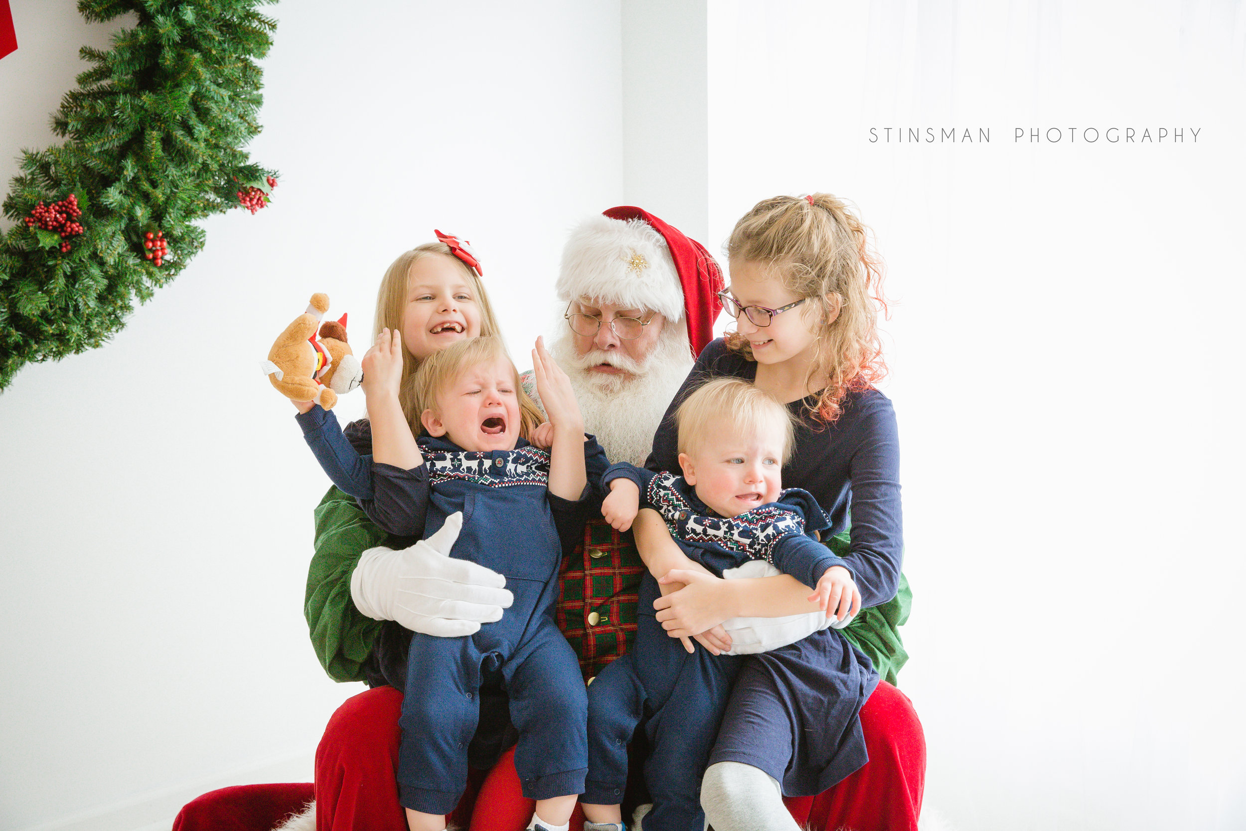 twin boys do not like santa but their older sisters do in burlington nj photo studio