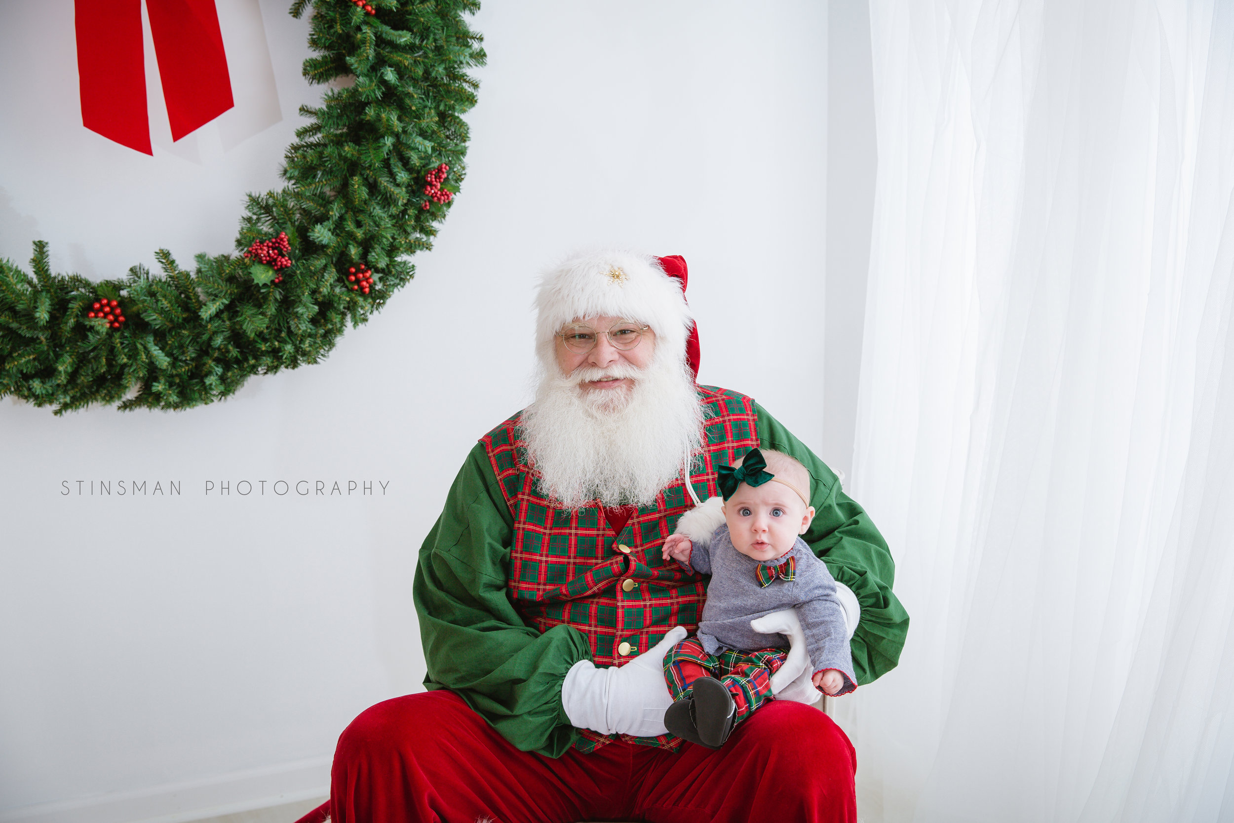 baby girl not liking santa at burlington nj photo studio