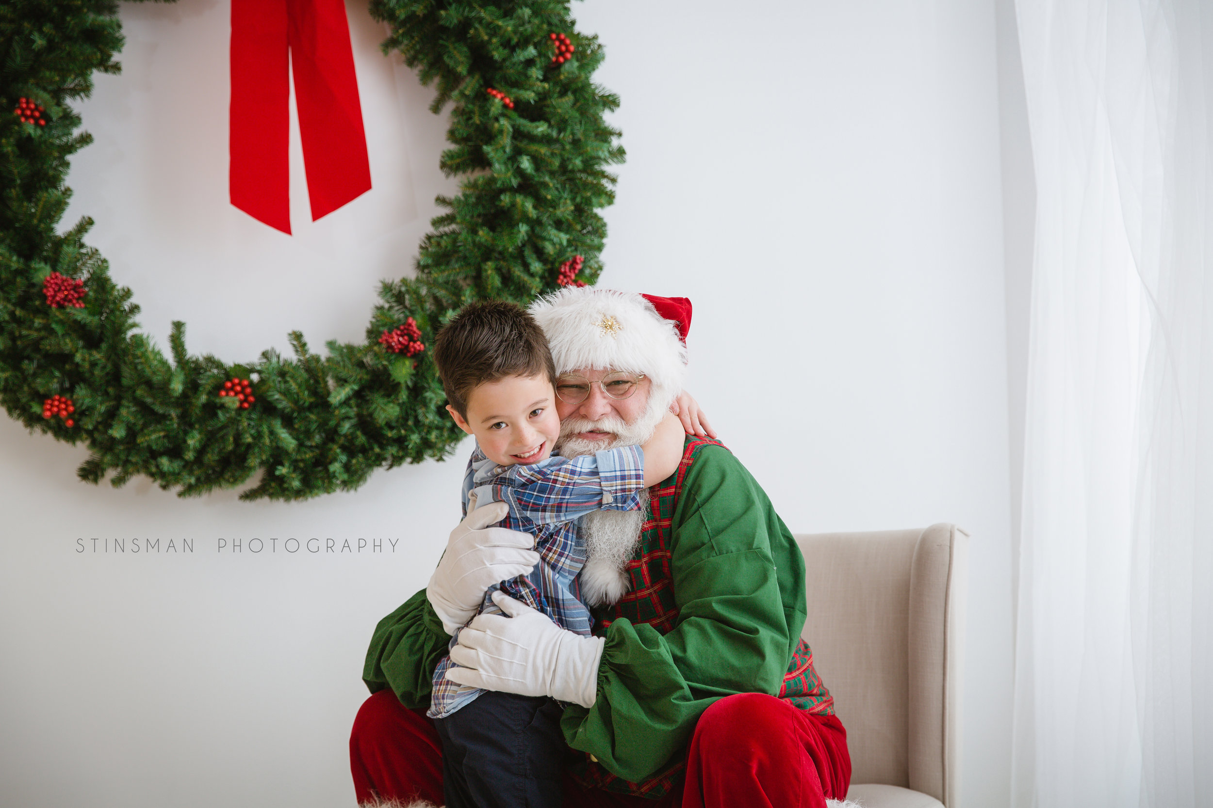 little boy reading with Santa in burlington NJ photo studio