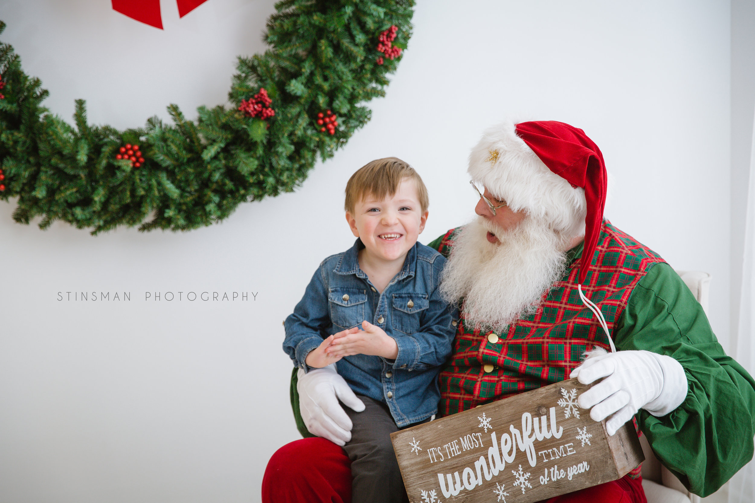 little boy hugging Santa in burlington NJ studio