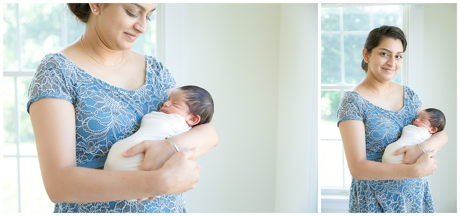 mom wearing baby blue holding her newborn baby boy in voorhees new jersey home session