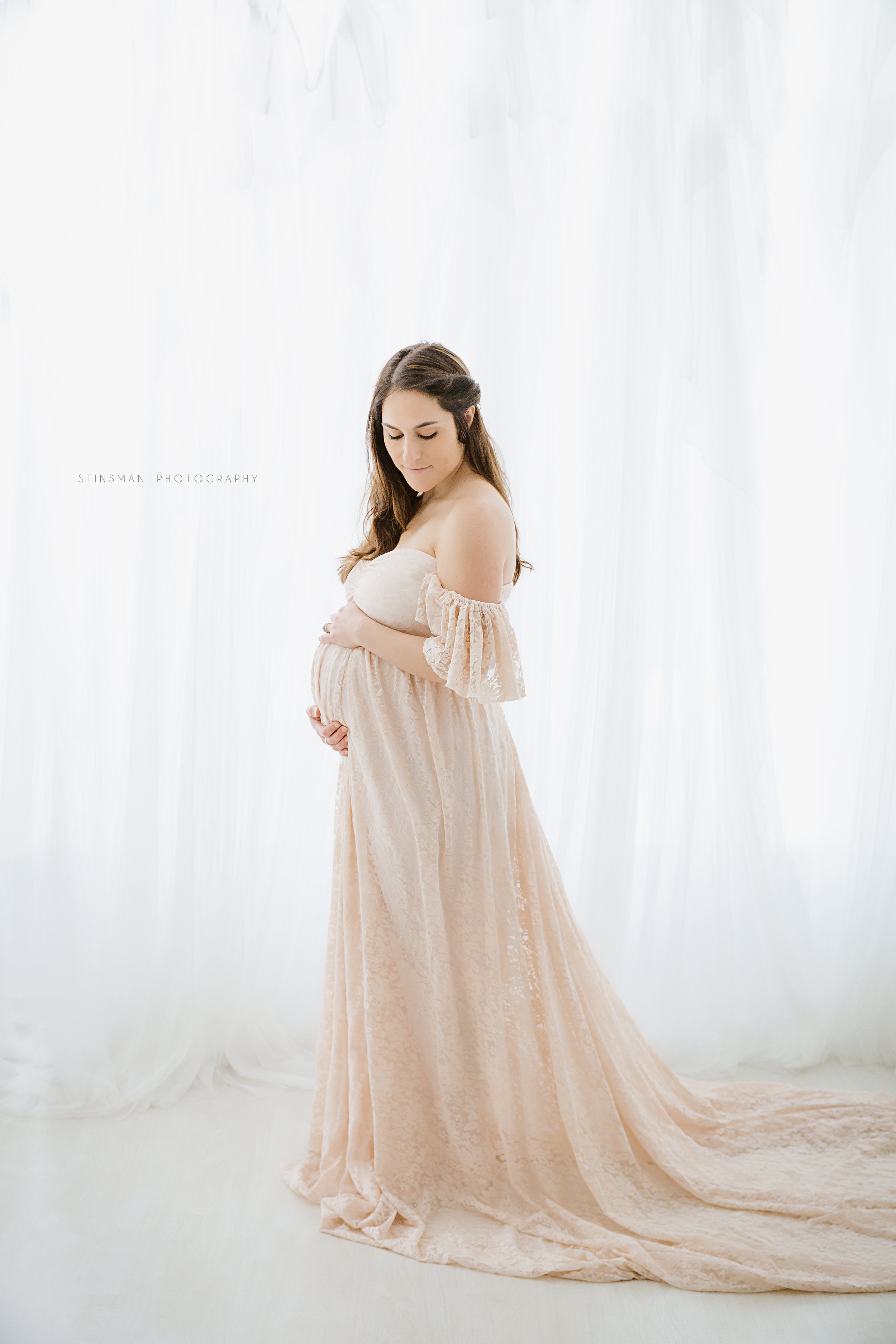 maternity-photo-shoot-with-6-month-pregnant-mom-who-is-wearing-a-lace-pink-gown