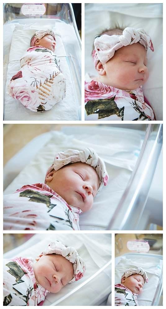 newborn baby girl swaddled in a flower blanket