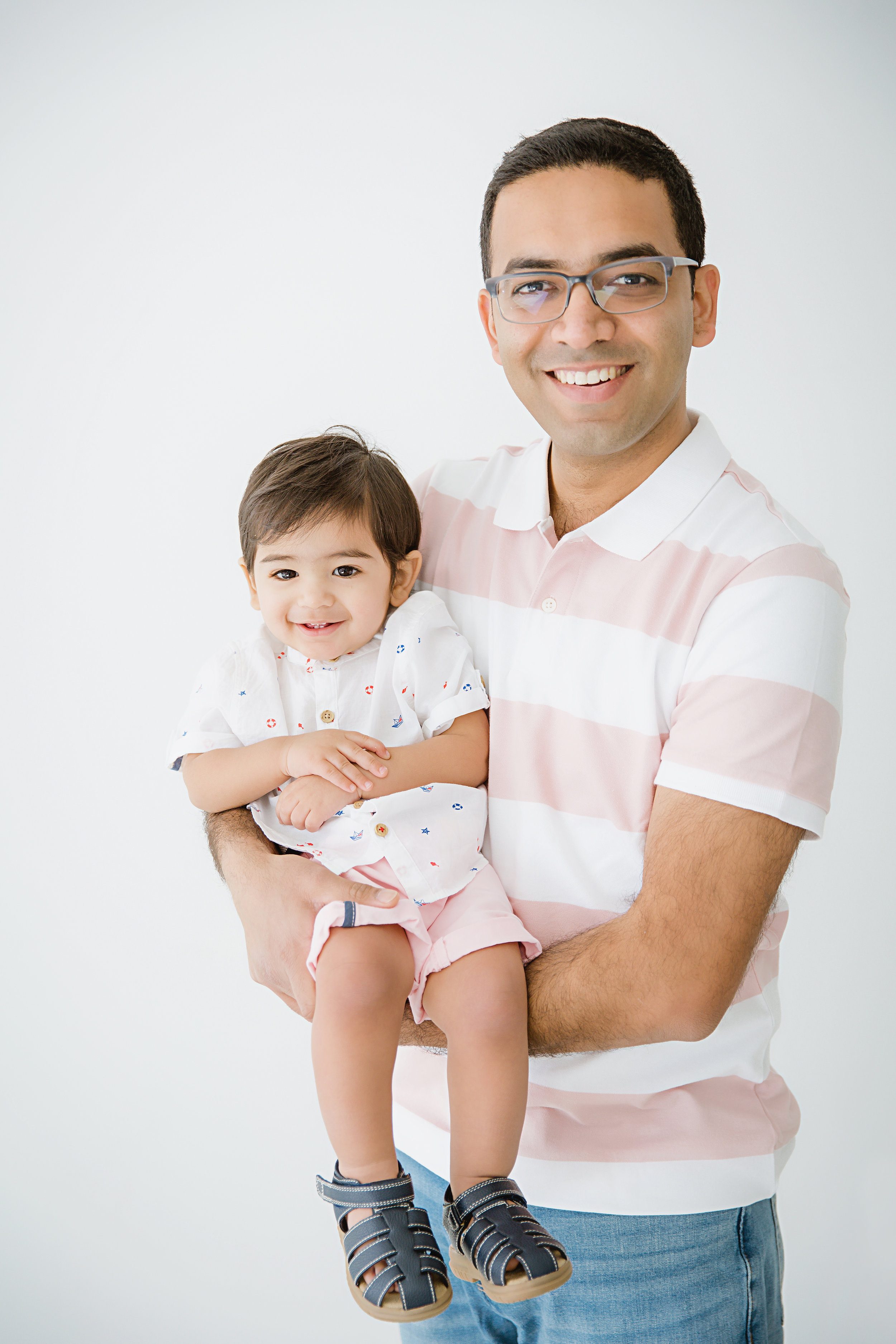 indian dad holding his son