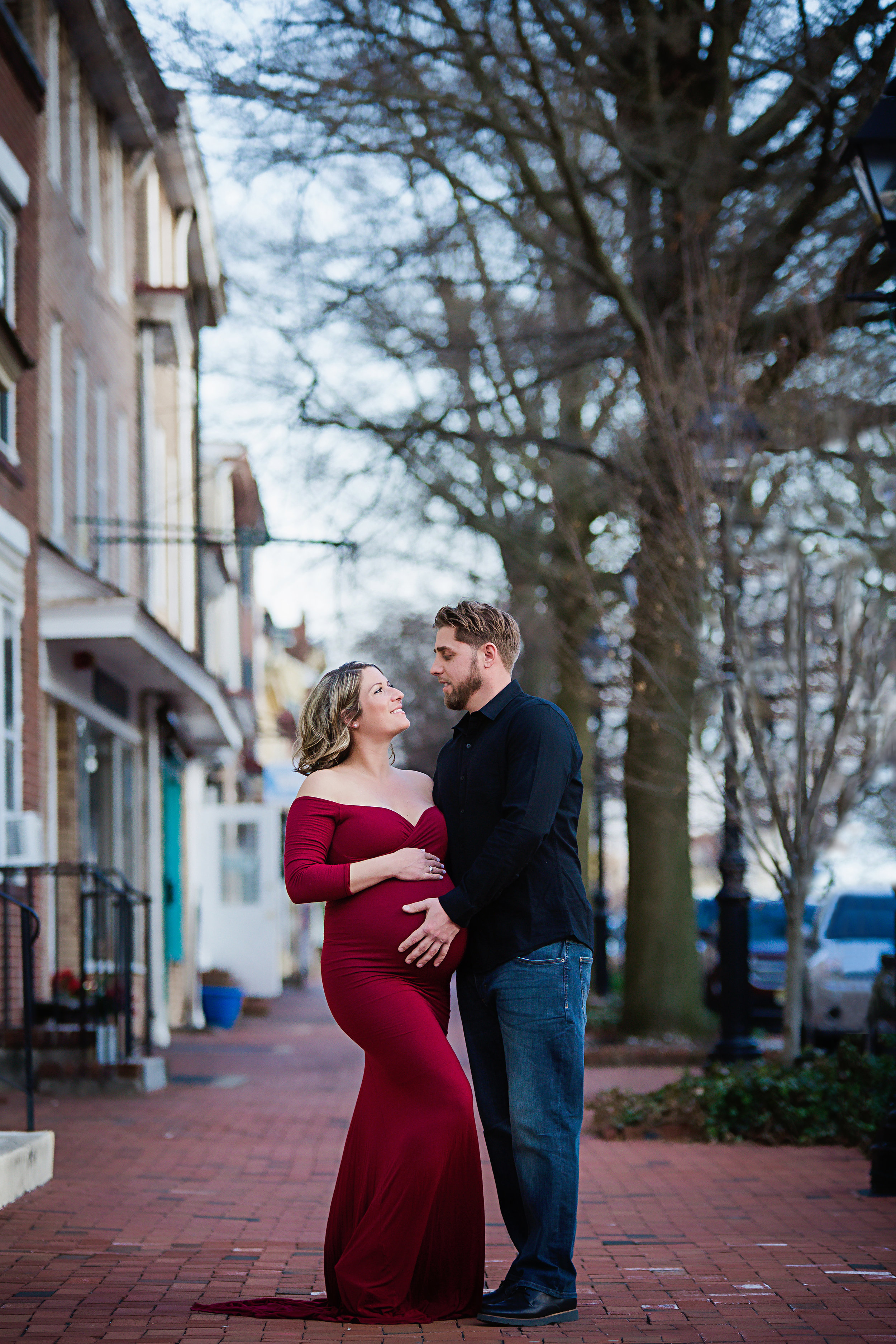 pregnany-mom-wearing-red-dress-on-brick-walkway-in-south-jersey-photo-studio
