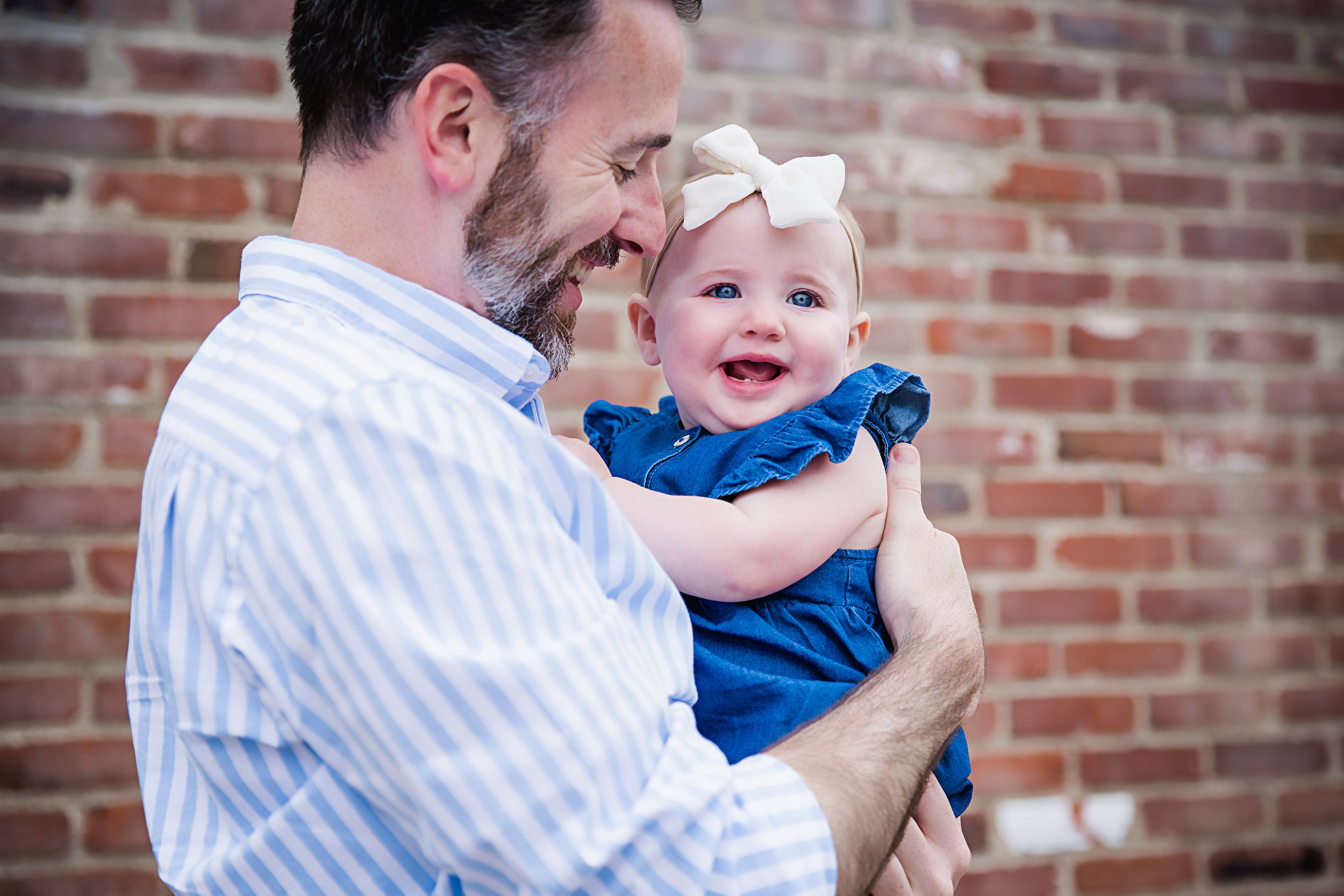 daddy-holding baby-first-birthday-photography