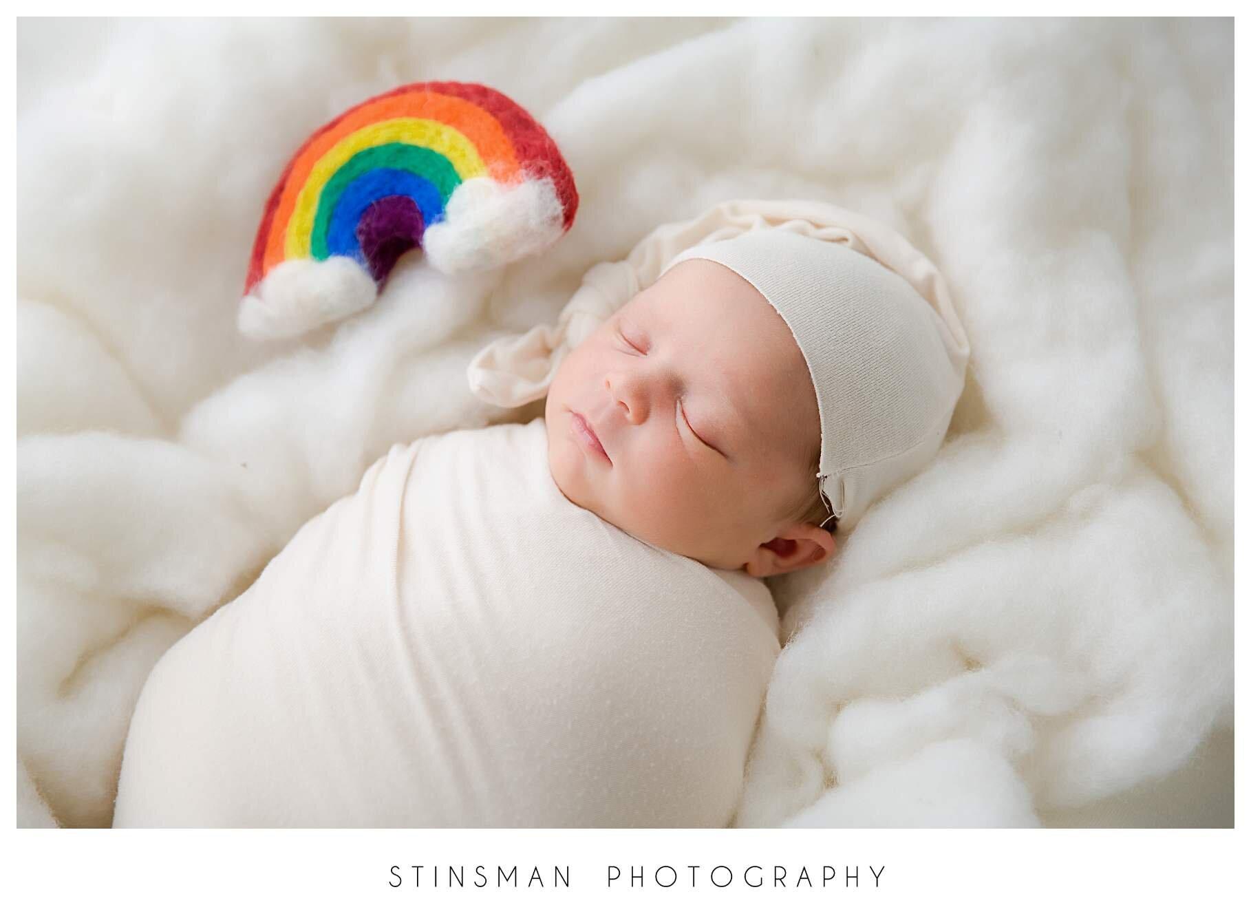 sleeping baby girl with rainbow