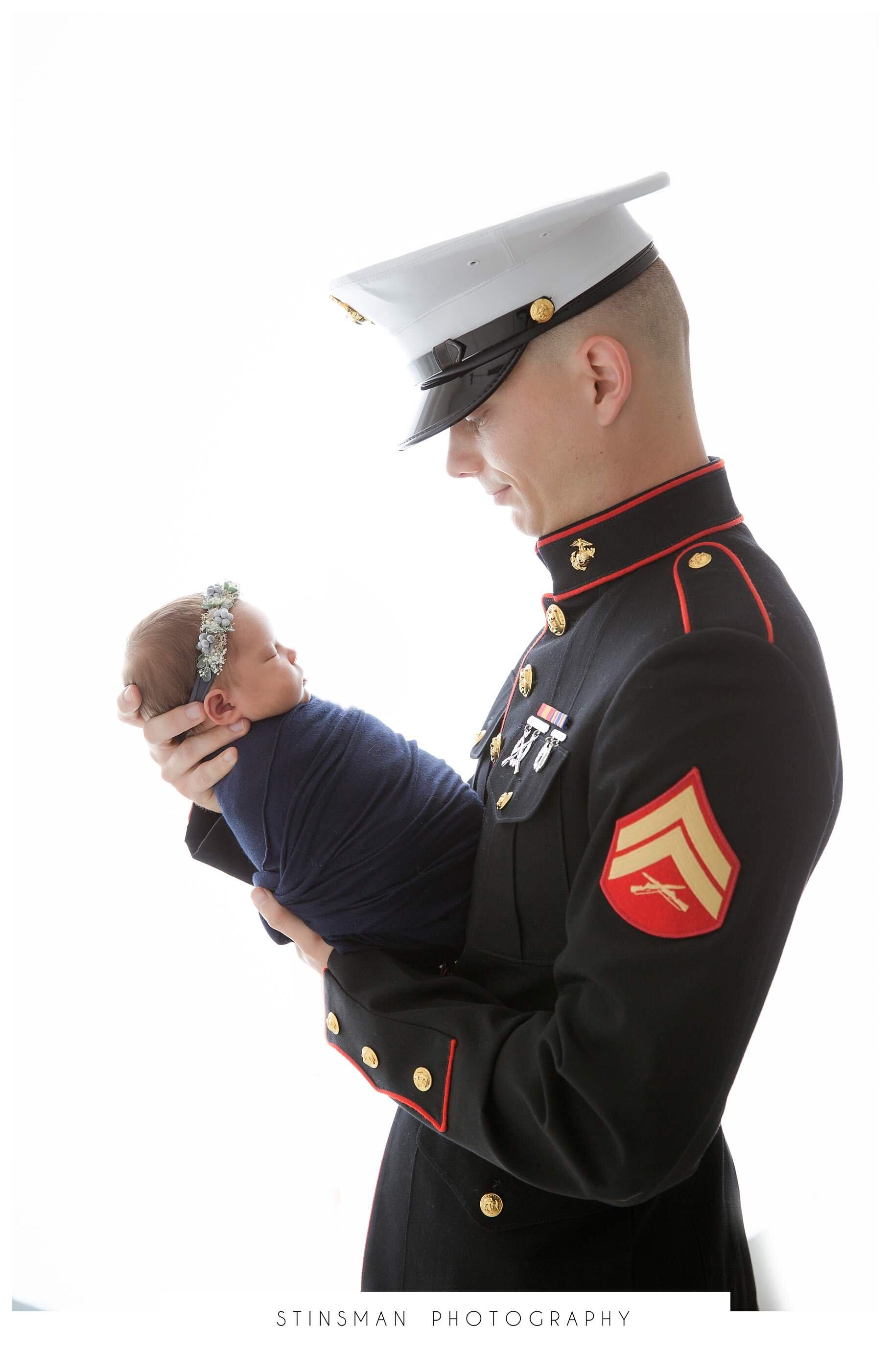 marine dad holding baby girl