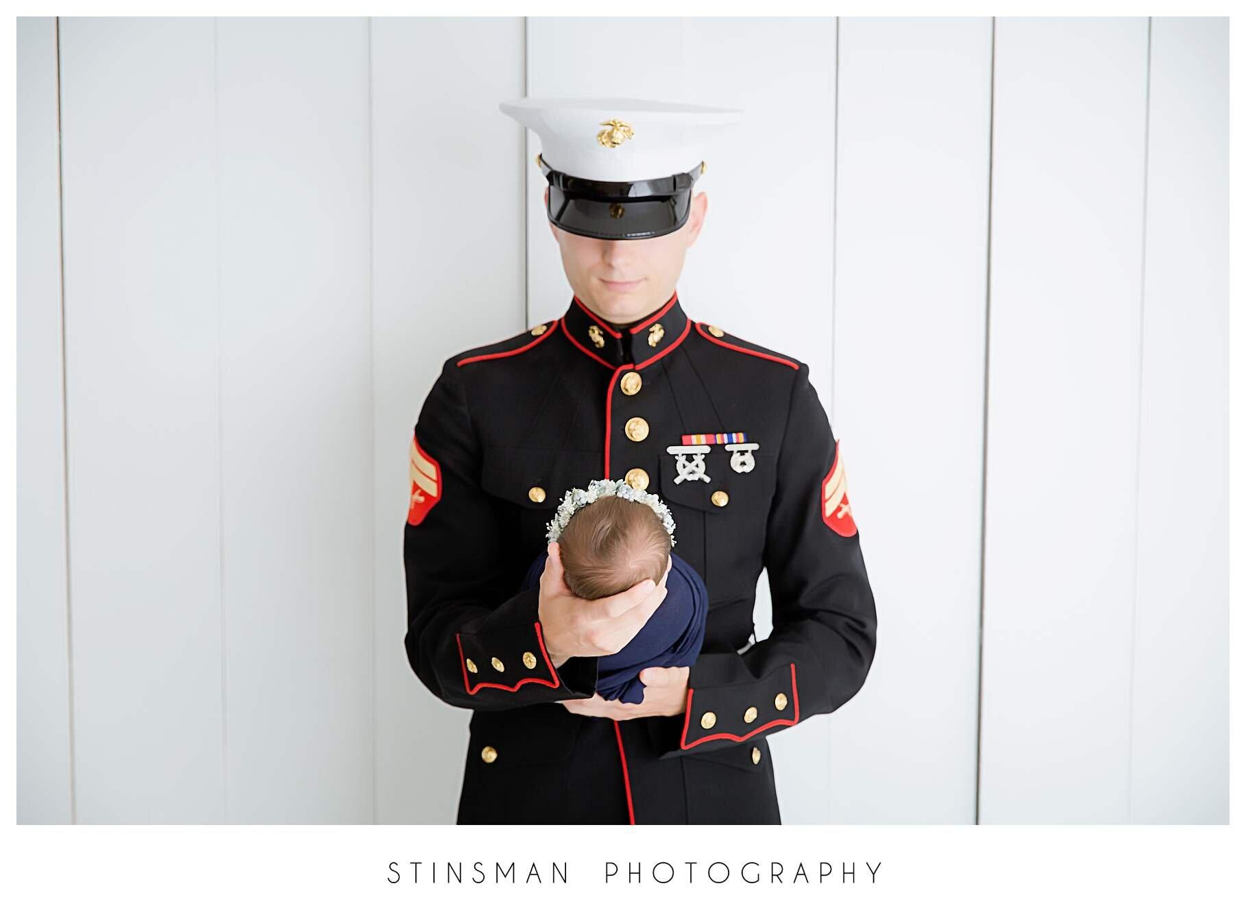 marine dad looking down at baby girl