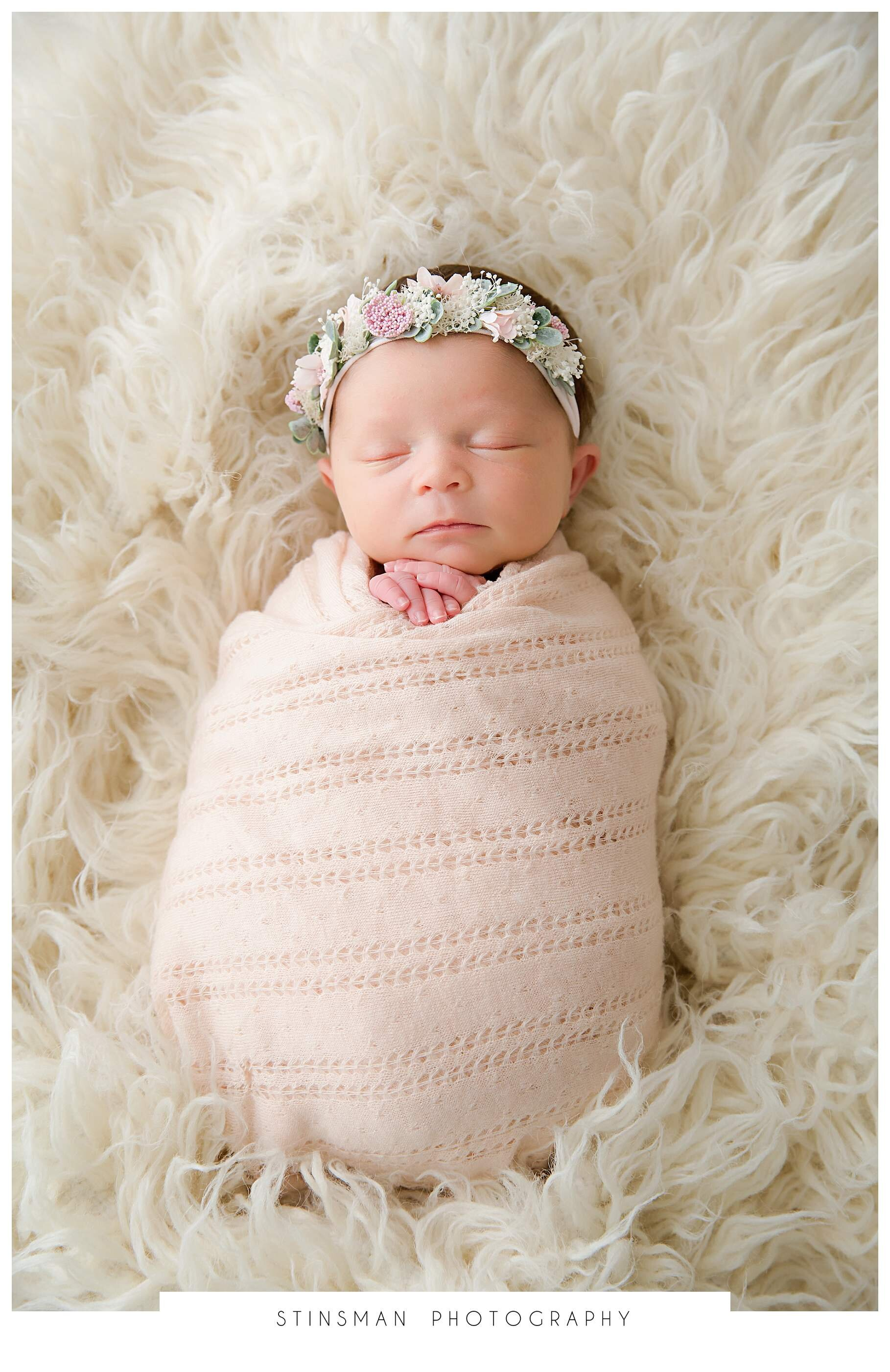 baby girl wrapped in pink