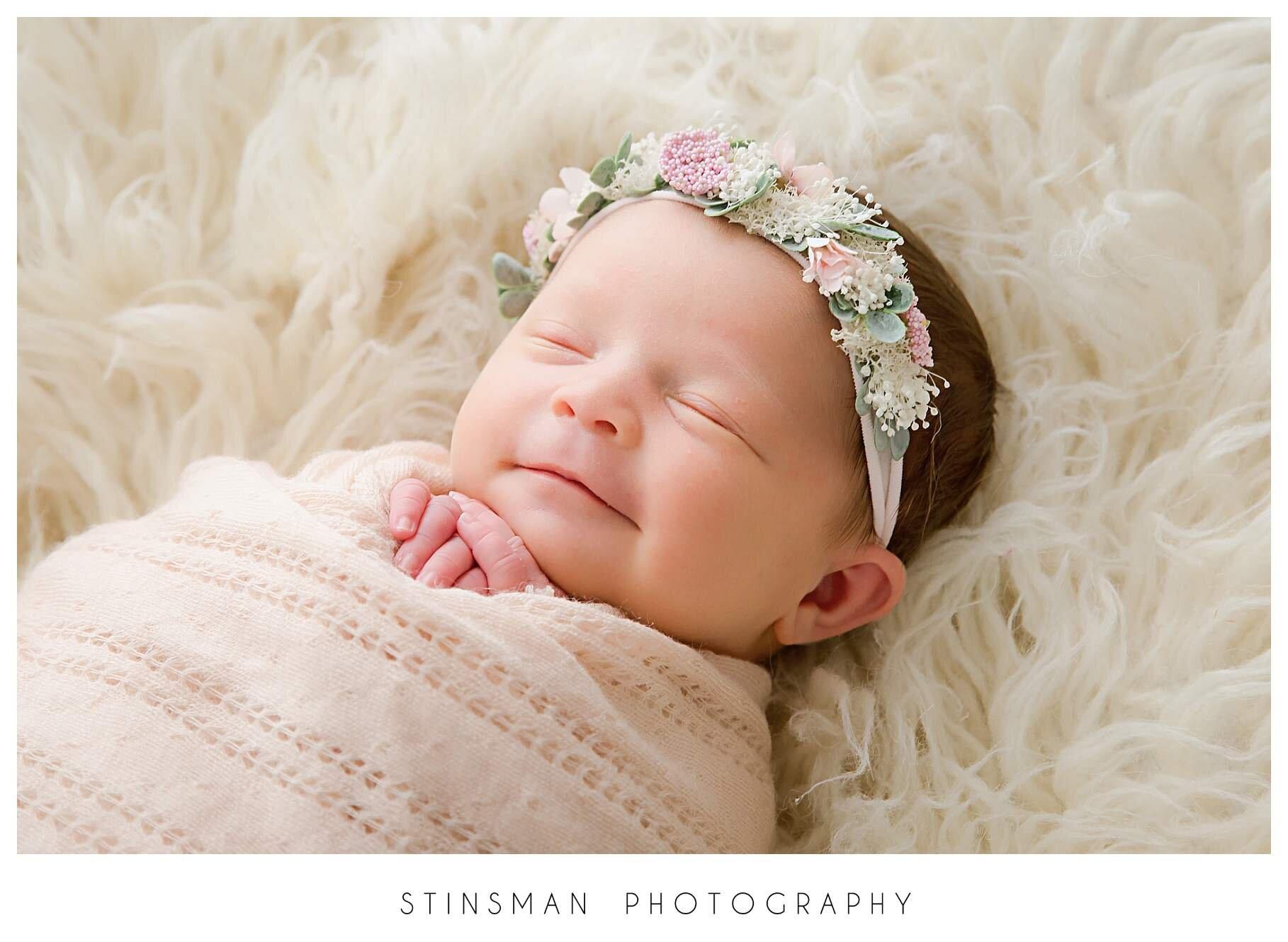 smiling 2 week old baby girl.