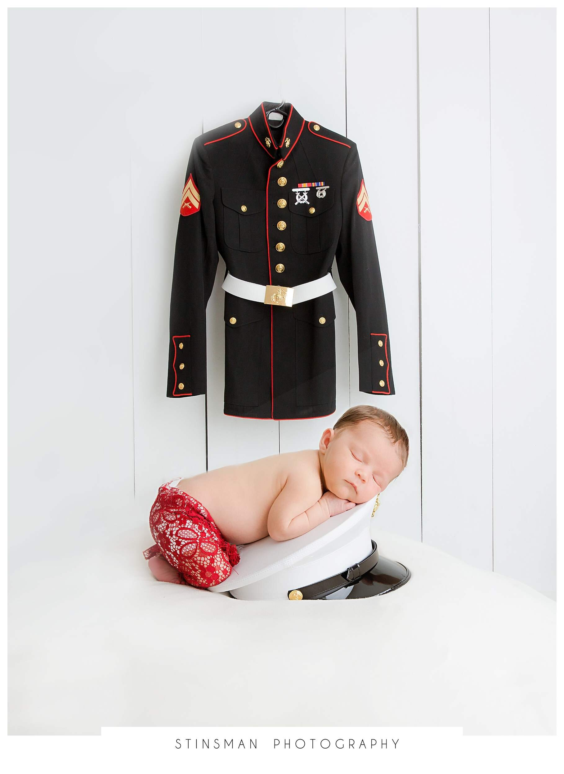 baby girl on marine hat