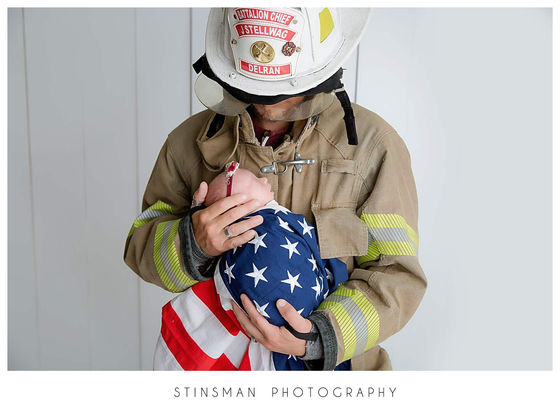 firefighter holding his baby girl