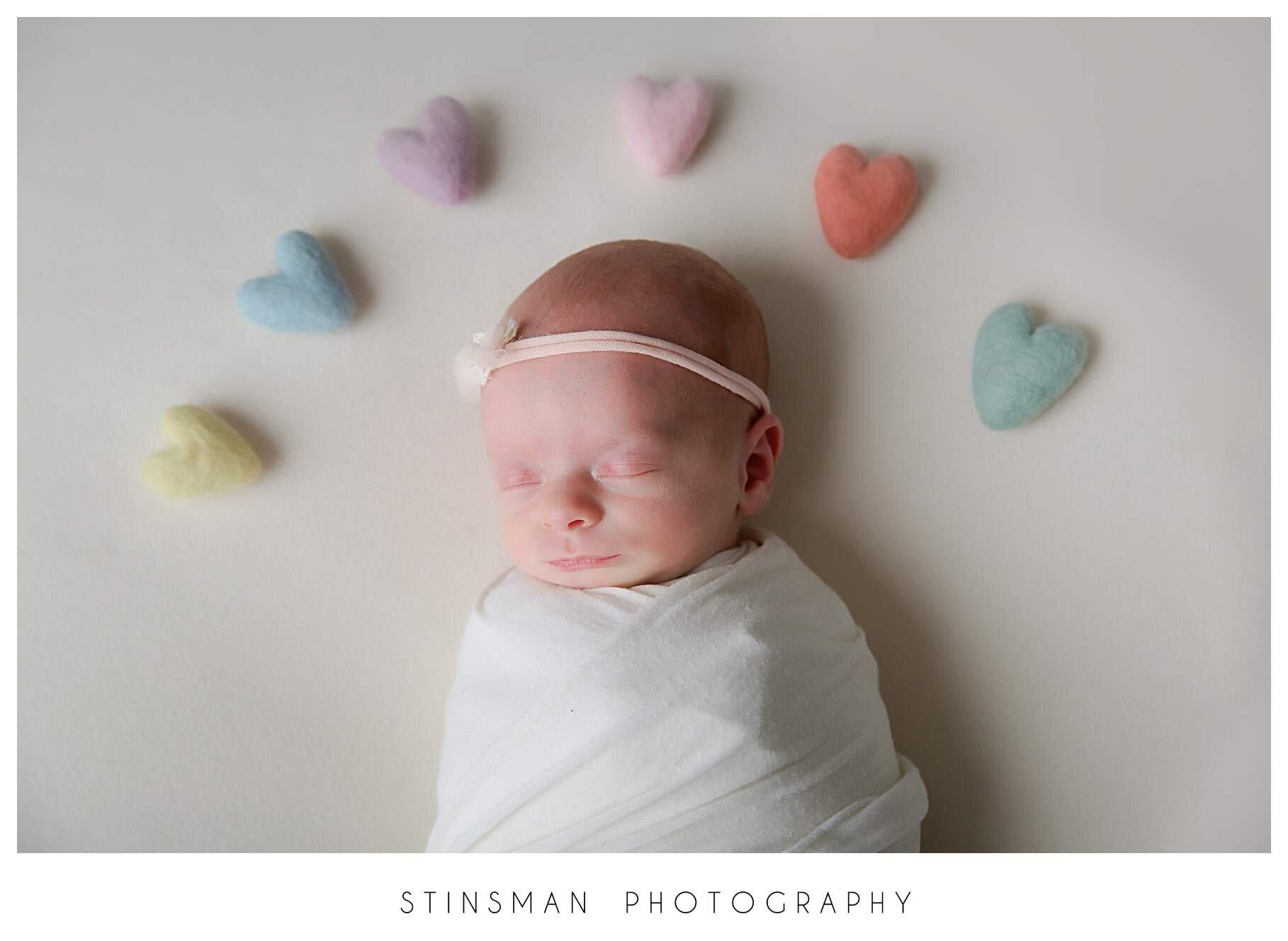 hearts around baby girl
