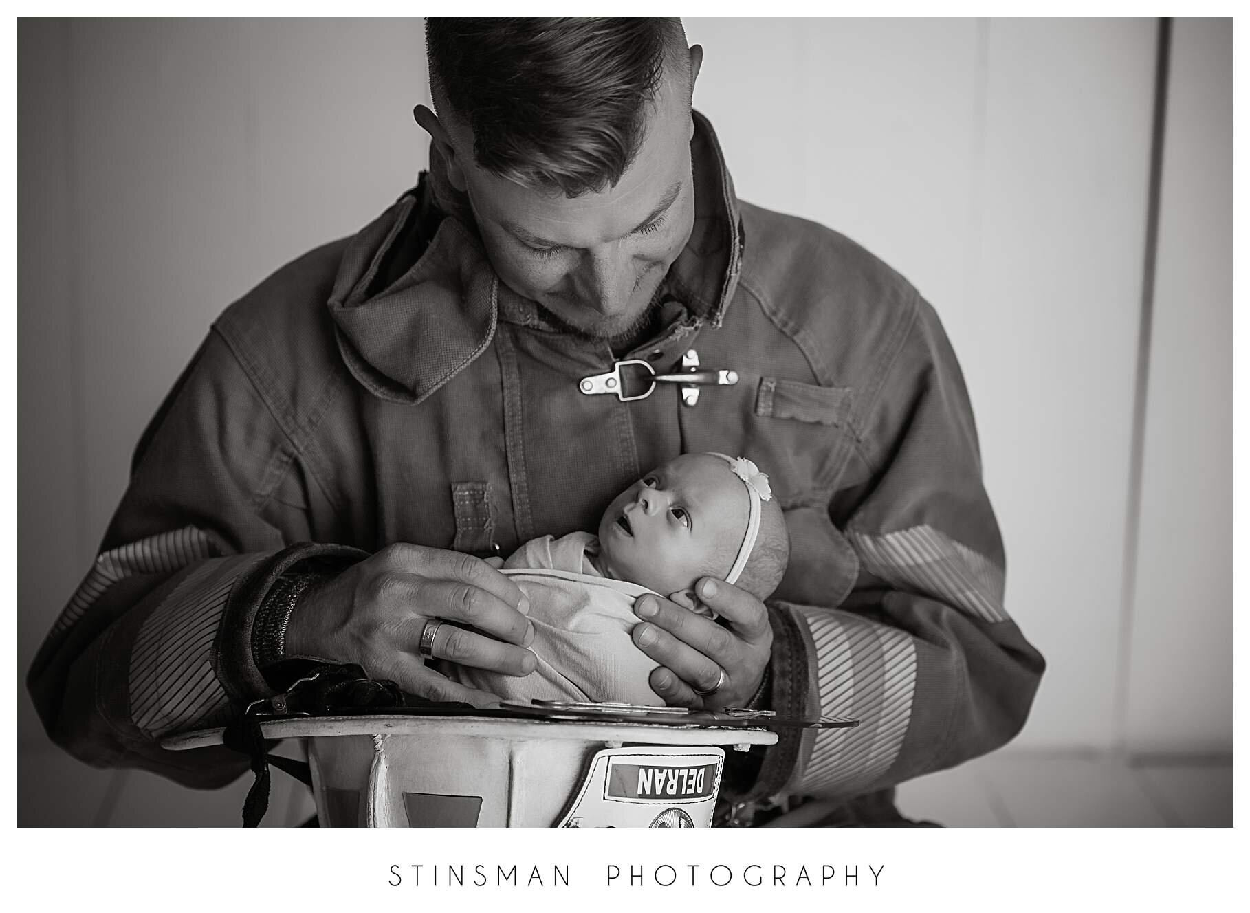 black and white photo of dad holding baby girl