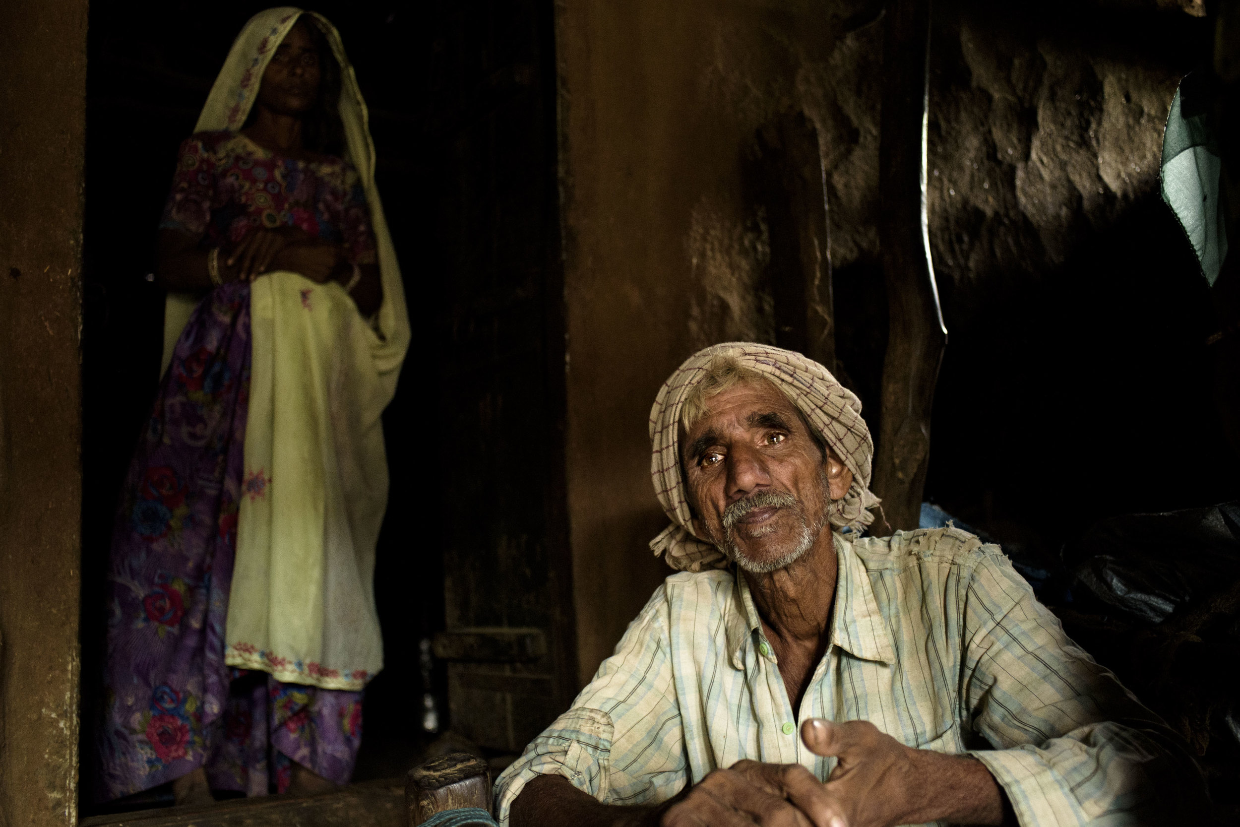 Bhura sits in the courtyard of his house while he explains how the Mukhyamantri Nishulk Dawa Yojna has benefitted him. Bhura lives below the poverty line. With very little income to support a family, he feels relieved that the diagnosis and medicine are free of cost.