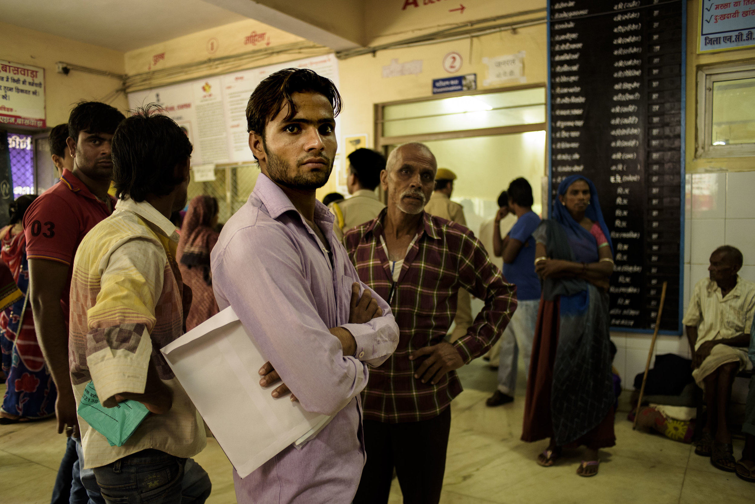 A man waits for his turn to get an appointment with a doctor in the lobby of the Mahatma Gandhi Hospital, Banswara. The district hospital has experiences an influx of more than 800 patients per day.