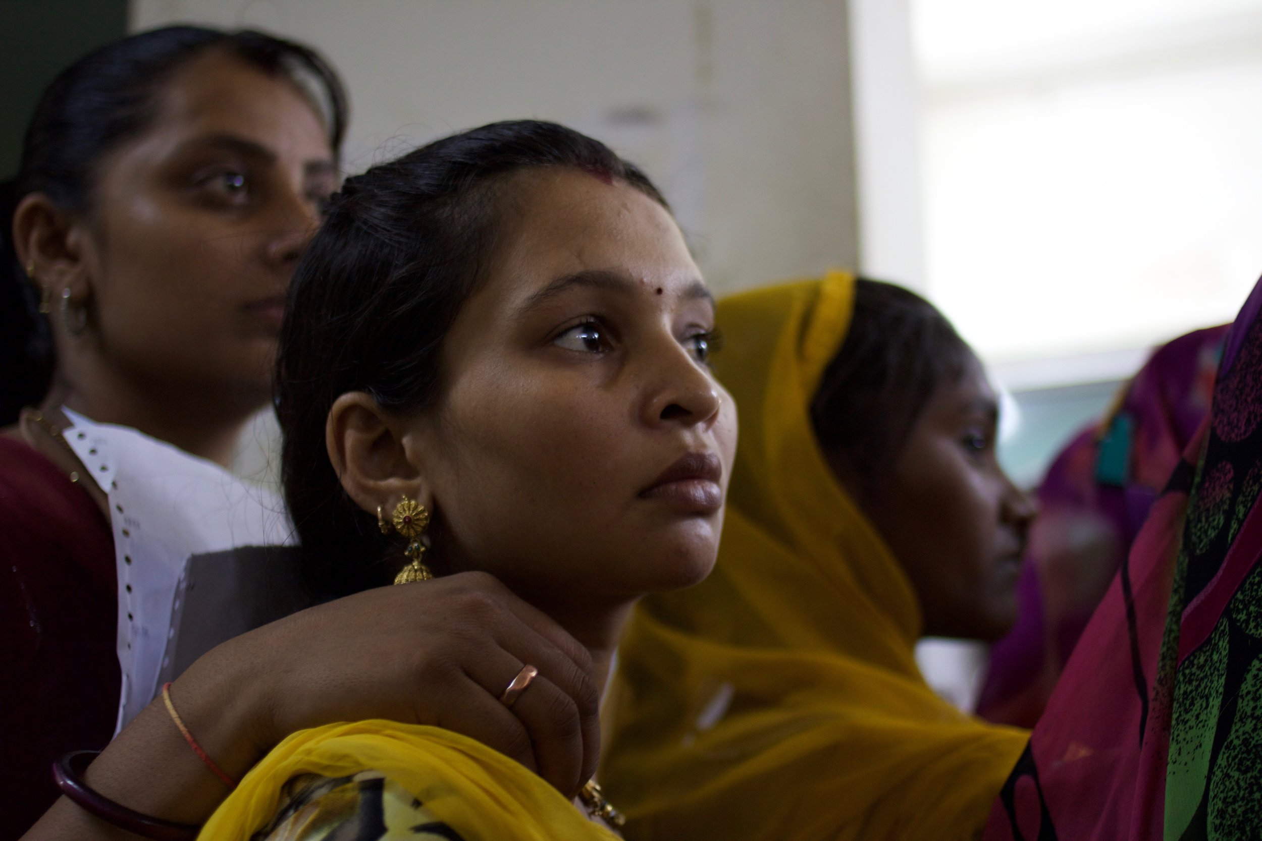 Pregnant patients who have come to Zanana Public Hospital for their regular check-up listen attentively for further instructions from the nursing staff.