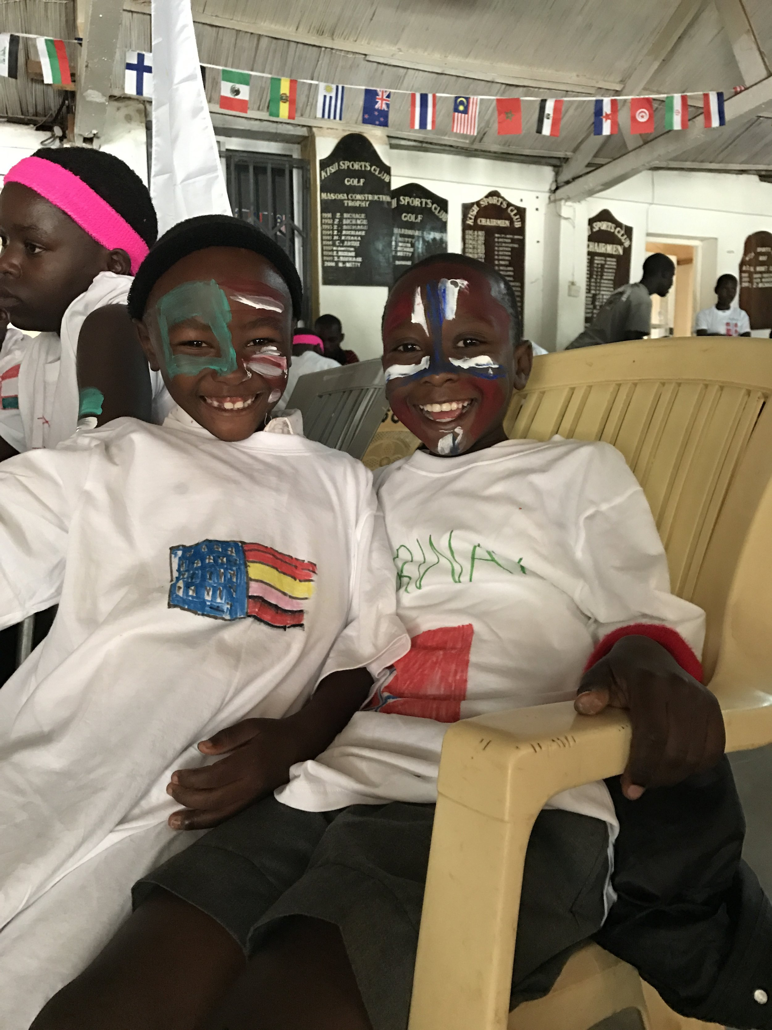 Enoch and Fabian representing team USA and team Norway at the Ajiri Olympics. They were cheered on by former Ajiri students.