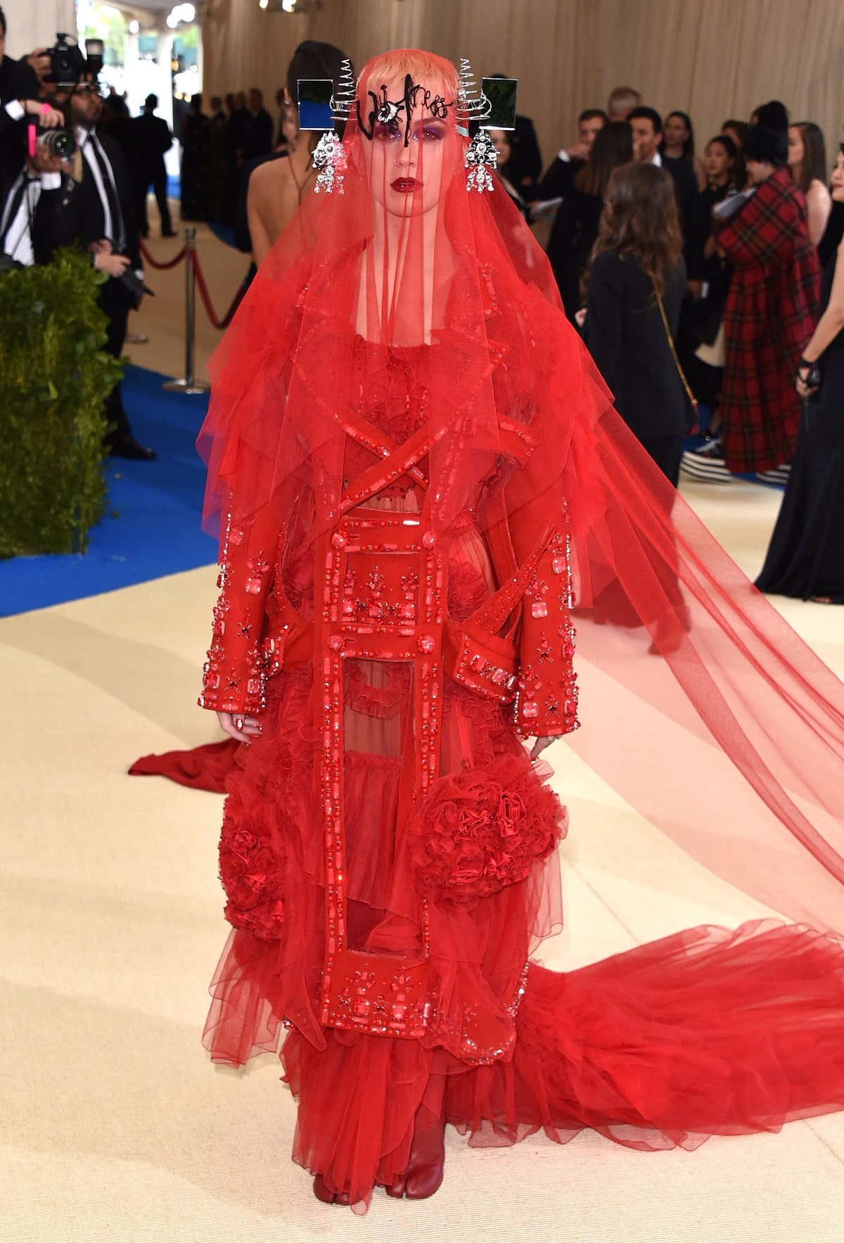 Katy Perry   in John Galliano.  I am not a label snob who will praise anything just because it's designer. This is straight up confusing as it is ugly. There is nothing flattering about this over embellished tulle, column, mesh gown. The headpiece could have been tossed too. Try again girl.