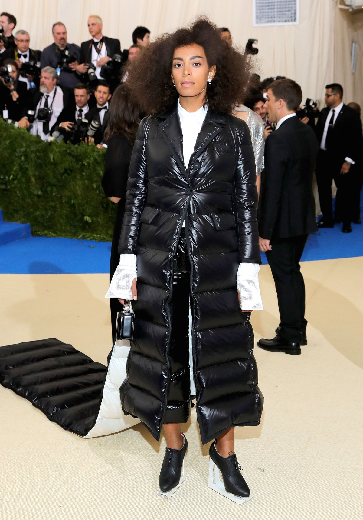 Solange Knowles   in Thom Browne.  I know New York may be colder than most places in the country but you can never use that as an excuse to have a down jacket train with matching ice skates. She has one of the world's most beautiful bodies under there and we would never know it.