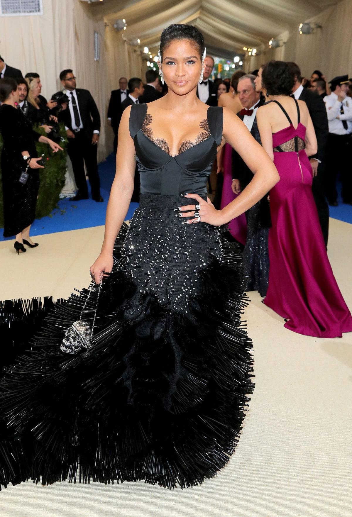 Cassie   in On Aura Tout Vu . The upper half of this dress could have been flattering but the more you look around the more you hate this dress. The spikes on the bottom remind me of car wash spindles and the pointy accessories are giving me porcupine vibes.