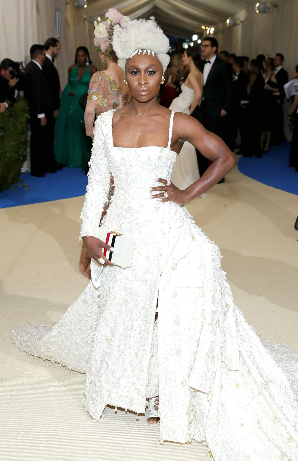 Cynthia Erivo in Thom Browne. All that comes to mind is The Hunger Games whistle and Elizabeth Mann's character Effie. Not sure what she was going for here. Perhaps Marie Antoinette?