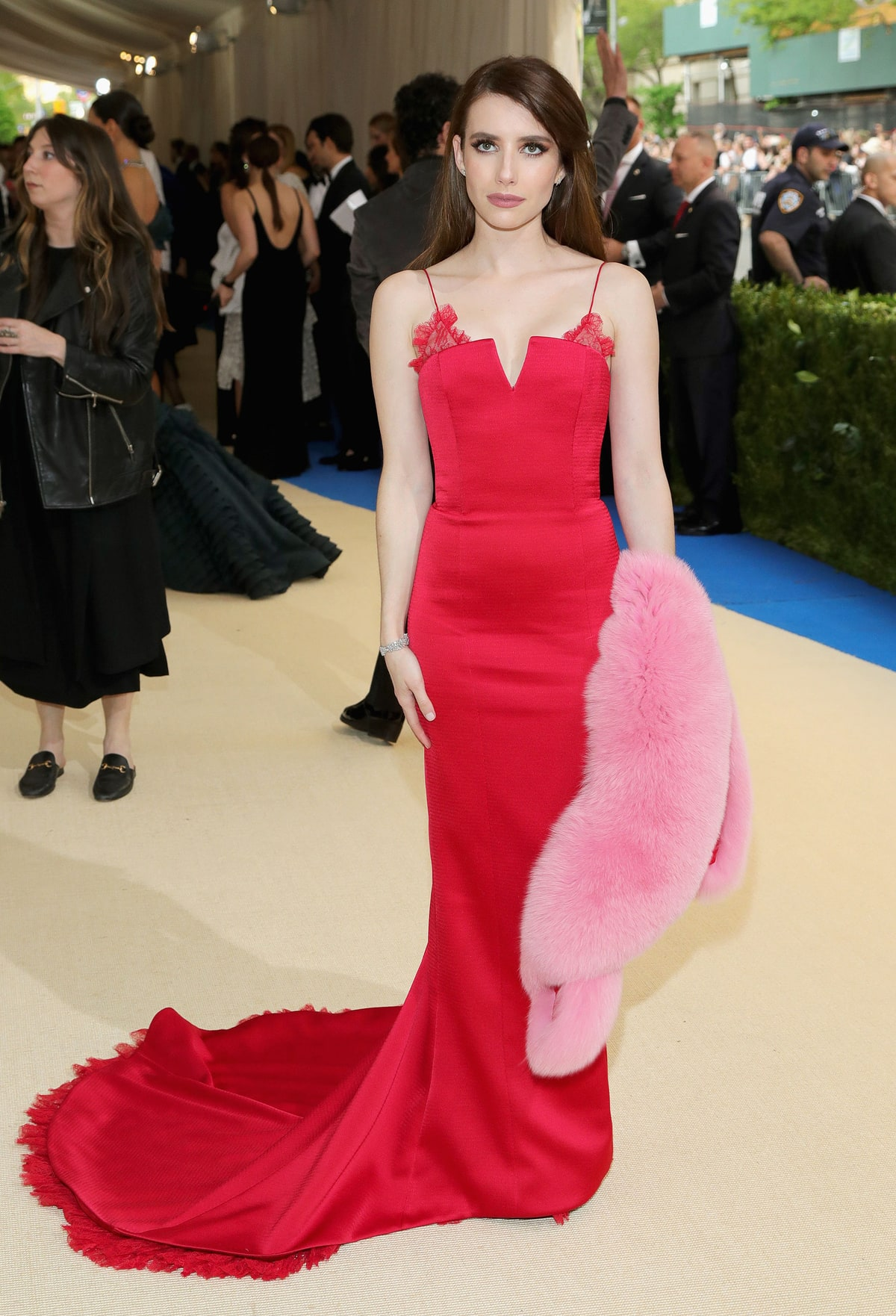 Emma Roberts   in Diane Von Furstenberg.  Hello TV-star! She looks amazing in this deep coral colored gown. We could have lived without the stole but she is serving fierceness in this perfectly altered dress with a fringe train.