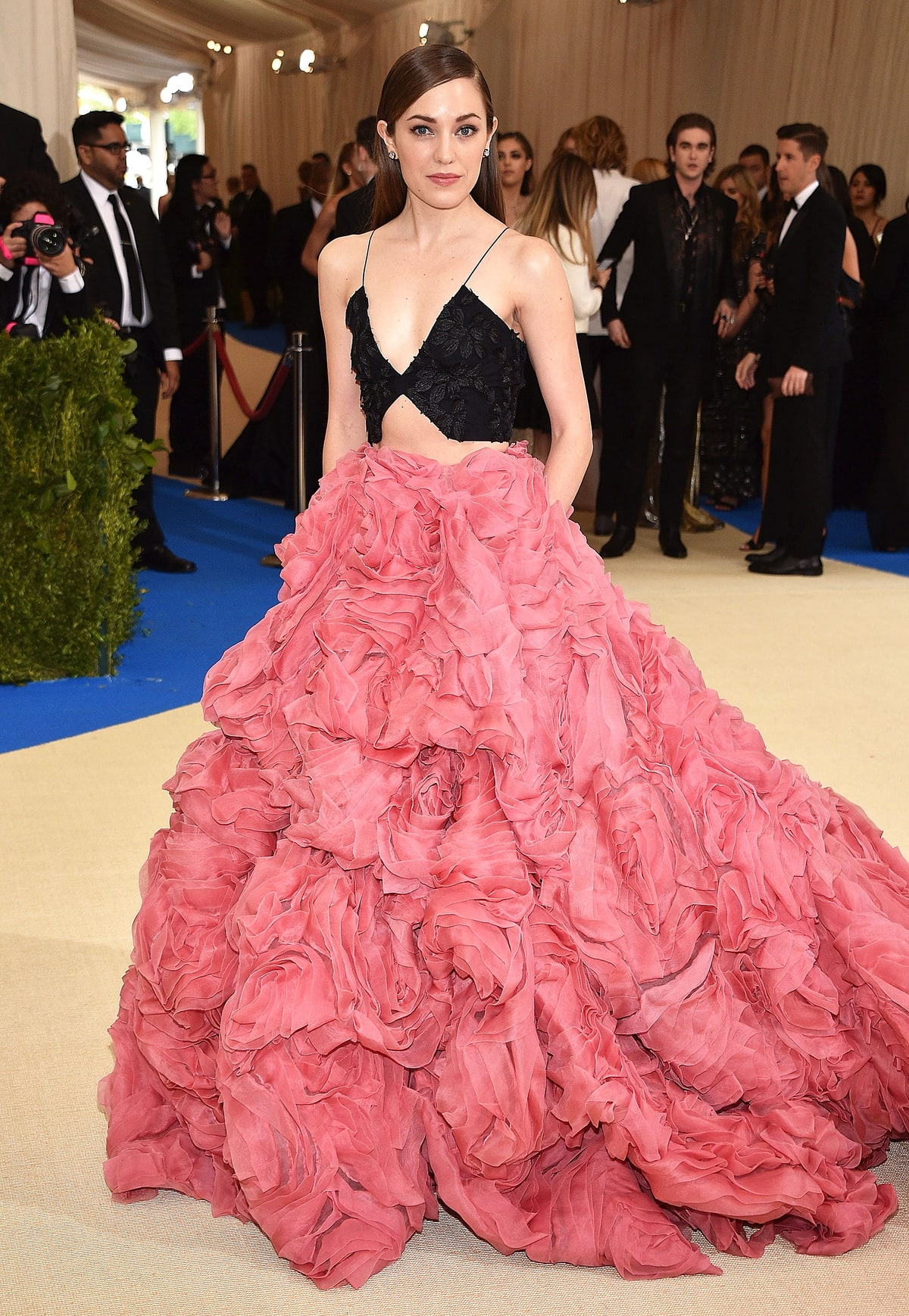 Laura Osnes   in Christian Siriano.  Not even sure who this lady is but she is giving me throwback Rihanna in that gorgeous Giambattista Valli dress in the same poppy colored hue a few years ago. I love the fact that the designer broke up the volume of the dress with the two pieces. She shined in this floral confection.