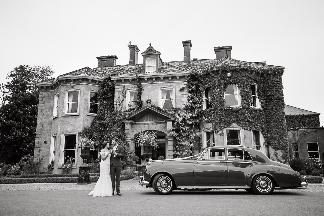 Classic black & white Wedding photo. Vintage Bentley. Tinakilly House