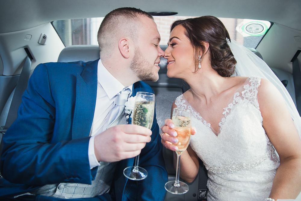 Bride & Groom wedding car champagne first kiss