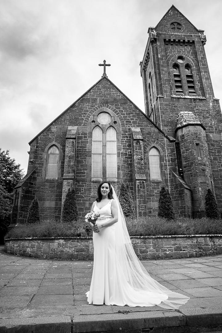 Michelle & David Radisson Blu Hotel & Spa Limerick. Monaleen Church, Bride Alone outside church
