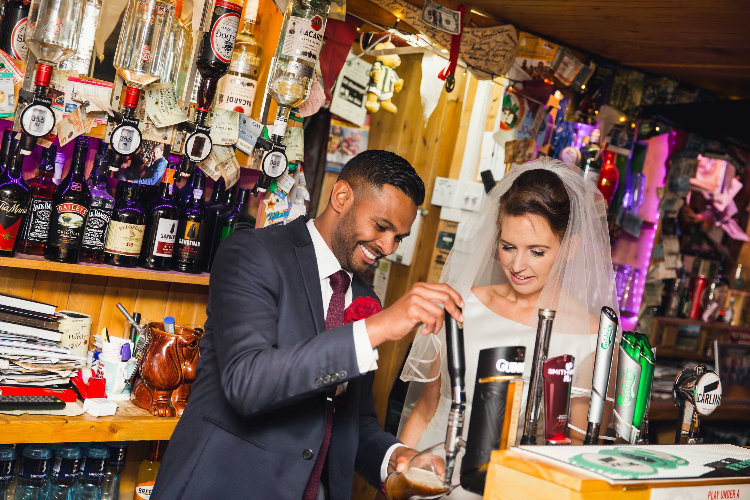 Radestown House Boutique Wedding Venue Co Kilkenny. The wedding of Suzi & Shai By Stargaze Photography Kilkenny. The wedding reception was held in Anocht Restaurant in the Kilkenny Design Centre. Bride & Groom pull a pint of Guinness in the bar.