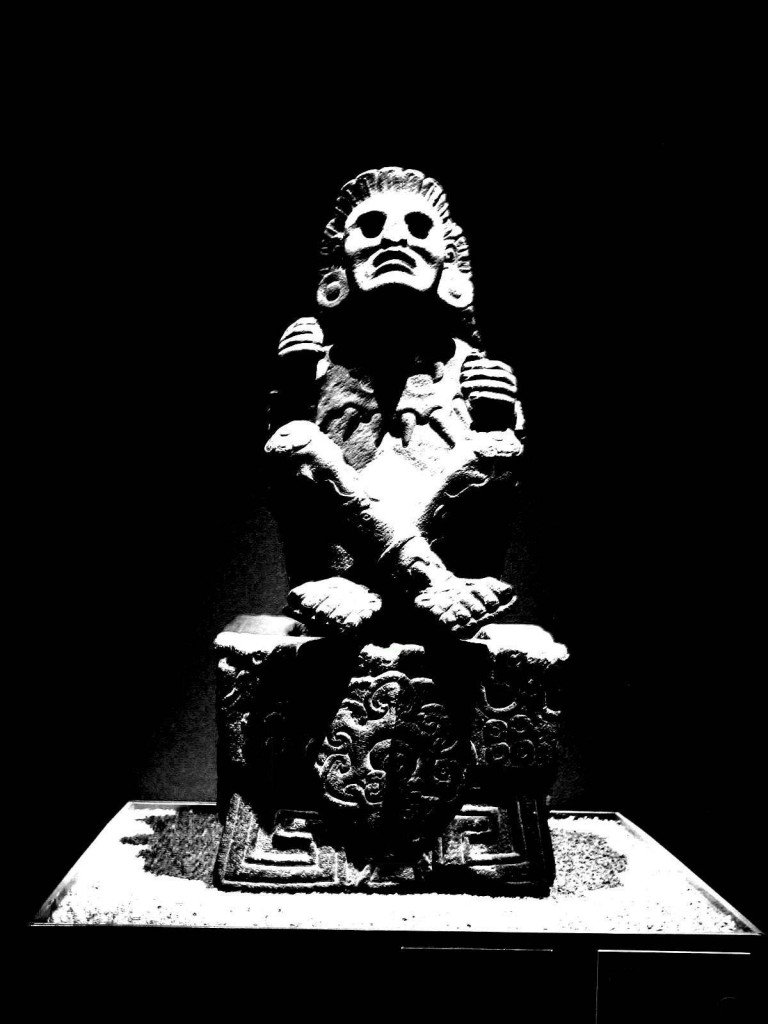 Ancient Aztec Medicine Goddess is poised in the usual peyote fashion. This stature used to hold a staff and gourd rattle.