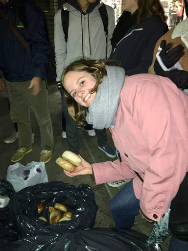 Josi Riederer, an NYU junior in GLS, eagerly picking up some bagels to take home.