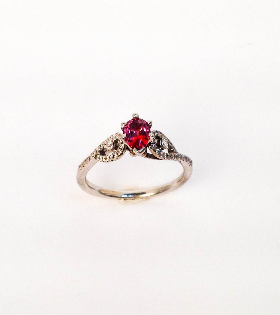 200-561 Mikesell's 14 Karat White Gold Fashion Ring with One 0.61ct Pear Shape Padparadshah Montana Sapphire and 0.18tw Round Diamonds $1,768.00