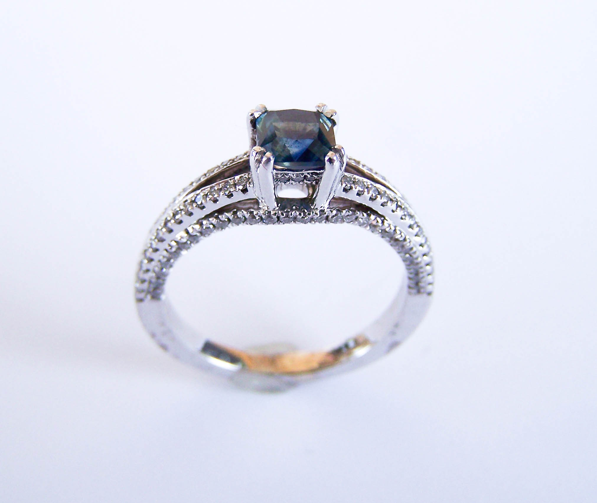 200-0698  Mikesell's, White 18 Karat Engagement Ring with One 0.82 Carat Radiant Montana Sapphire and 0.43tw Round Diamonds $2,075.00