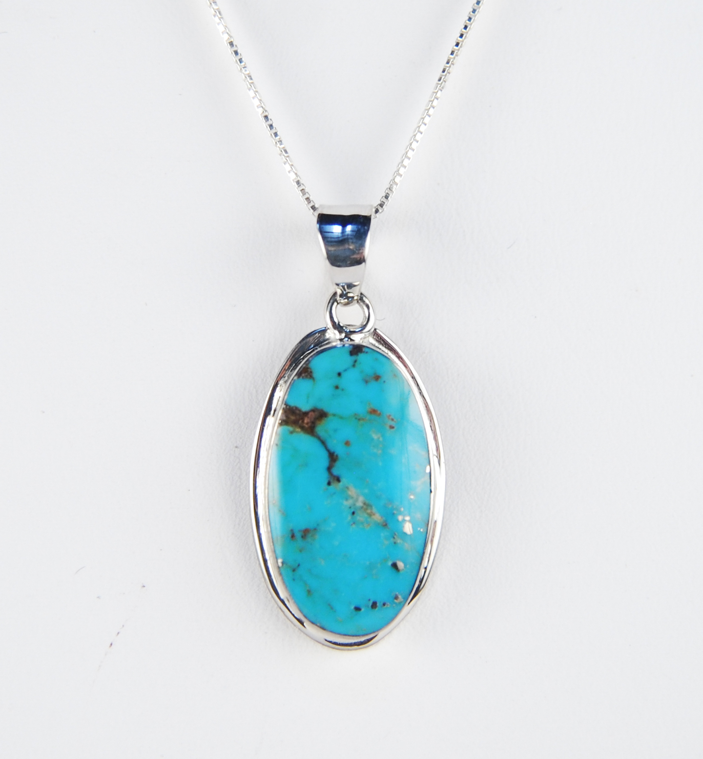 660-965  Sterling Silver Pendant With One Cabochon Turquoise $75.00