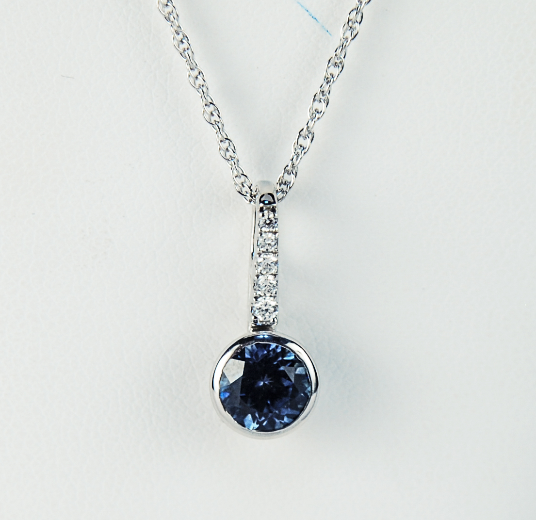 230-1852   14 Karat White Gold Drop Pendant With One 1.20Ct Round MT Sapphire And 0.07Tw Round Diamonds $1,747.00