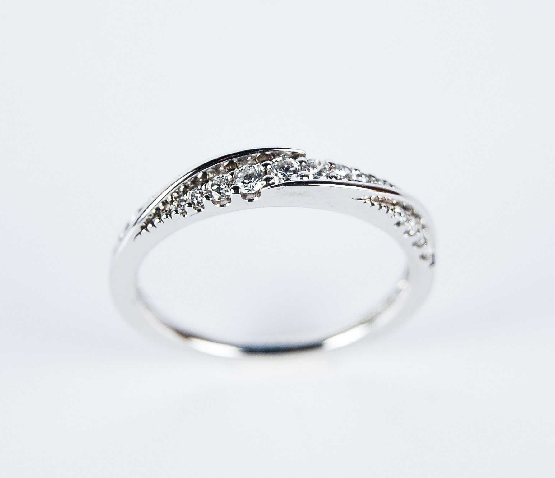 110-402   14 Karat White Gold Wedding Band Size 7 With 0.25Tw Round Diamonds $1,190.00